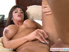 Busty milf Ariella Ferrera gives titjob