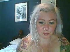Tattooed blonde nympho exposes her big natural breasts on the webcam