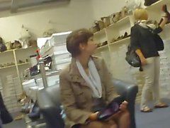 candid black nylon feet in shoe store