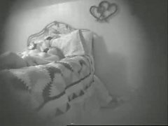 Young Woman Fingers Herself in Bed - Hidden Cam