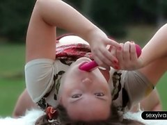 Playful sexy Ivana sucking a vibrator outdoor