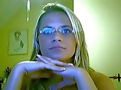 Blonde girl in glasses teases and touches herself on her cam show