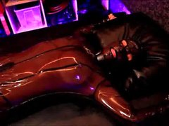 Rubber Girl in transparent latex suit tied-up