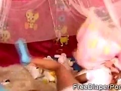 Brunette and ebony babies turn kinky when wearing diapers