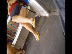 Candid teen feet in flip flops in train