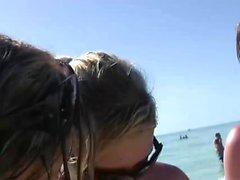 Hot girls strip down on the beach