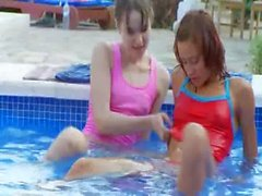 Wet girl2girl kissing by the pool