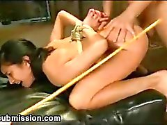 Bound arms babe anal fucked and caned in dungeon