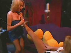 Busty blonde in nylons sucks other babes feet in this fetish video