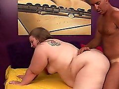 Fat chick Jessie plays out her fantasy with a hung stallion on the bed