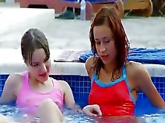 Wet lezzies kissing by the swimmingpool