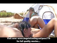 Threesome having lesbian orgy on the beach