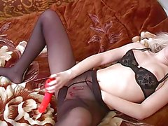 Chick masturbating in pantyhose