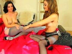 Two brunett lezzies teasing in nylons