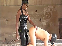 ebony strapon latex