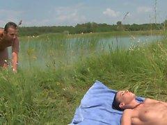 Slender brunette sucks guy's tool after a swim in the lake