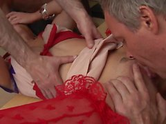 Affectionate babe blowjobs two giant peckers all in one time