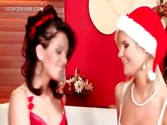 Sensual lesbos celebrating Christmas with a hot kiss