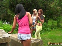 Lesbians peeing outside