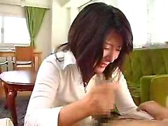 Mesmerizing Japanese girl working her lips and hands on a s