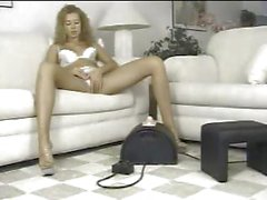 Blonde cutie Laura fingers her pussy and rides on a Sybian