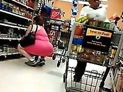 Big Woman In Pink At The Grocery Store