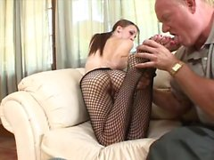 Horny brunette in fishnets uses her feet and mouth to get him off
