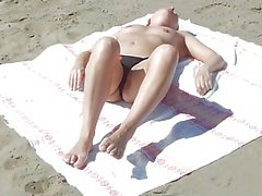 candid beach mom sunbathing