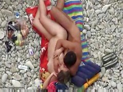 Couple laying out on the beach fucking are caught by hidden cam
