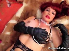 Sexy Redhead Rolls On Fur
