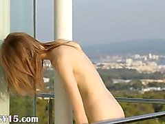 Top skinny schoolgirl on the balcony