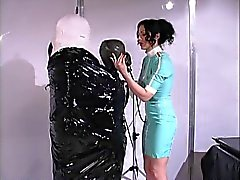 Chick gets wrapped in latex at day spa