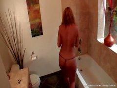 Blonde MILF gets nasty in the bathroom
