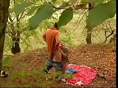 Cock loving blonde whore deep throats in forest