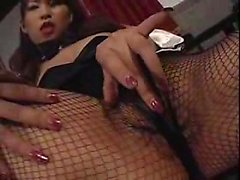 Sultry Asian babe in lingerie flaunts her curves and touche