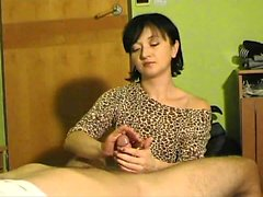 Enticing brunette is an expert in the fine art of stroking