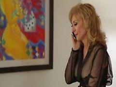 Lili Cade fucks Nina Hartley very hard from behind