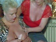 Three busty mature sluts sucking one cock