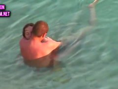 Mature couple sex in the sea