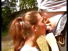 Cute little brunette gives this old dude some head and fucks him outside