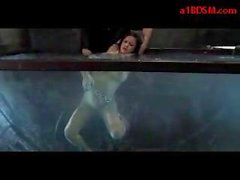 Girl With Tied Arms Tortured With Shocker Getting Her Pussy Rubbed With Dildo In The Aquarium By Master In The Dungeon
