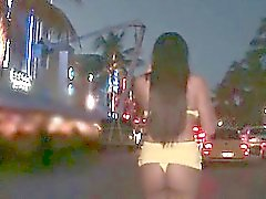 Tempting babe flashing fine ass in tiny strings on the streets
