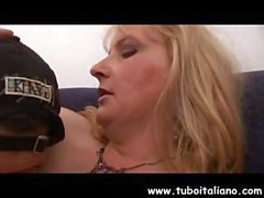 Busty mature Italian blonde gets fingered and sucks his cock