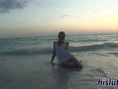 Luscious teen strips down on the beach