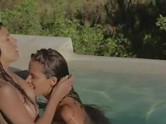 darkhair lesbians make love in the pool