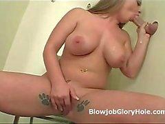 Big tits Katy gives blowjob through gloryhole