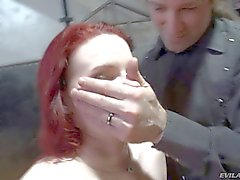 Redhead gets smothered by John Stagliano