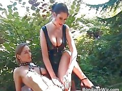 Bondage threesome outdoor action