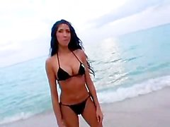 Brunette with bikini fucking her pussy