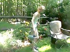 Skinny girl masturbates in the garden area